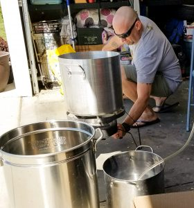 Mike Hopp brewing beer in his garage.